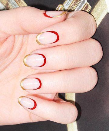 Unhas francesinhas douradas com meia lua vermelha