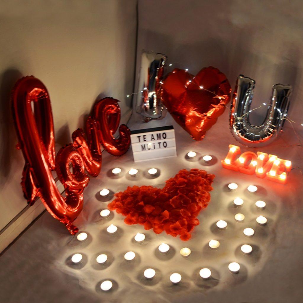 surpresa para o namorado com balões e velas